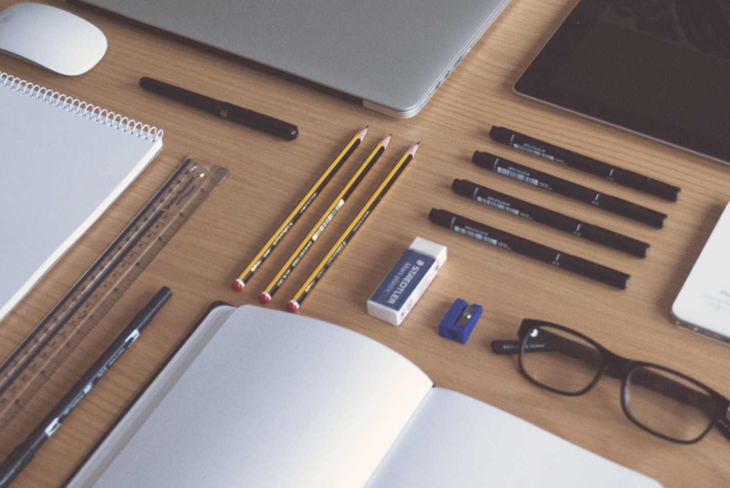 Pencils and Pens on desk