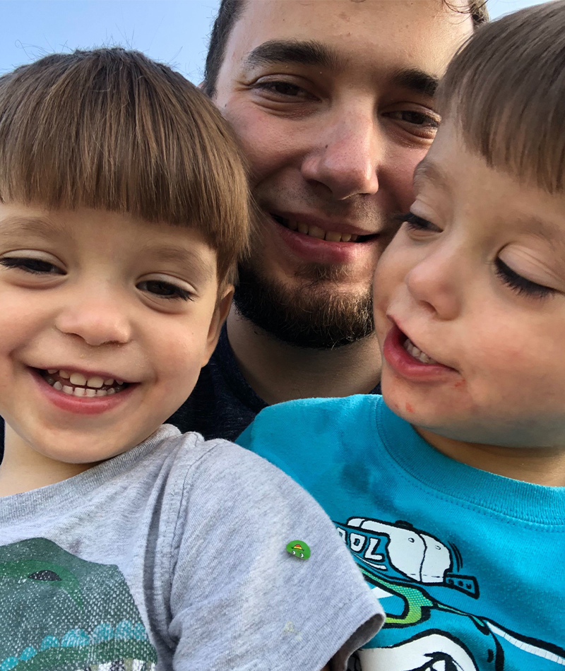 Brandon with his twin boys ready to take a selfie.