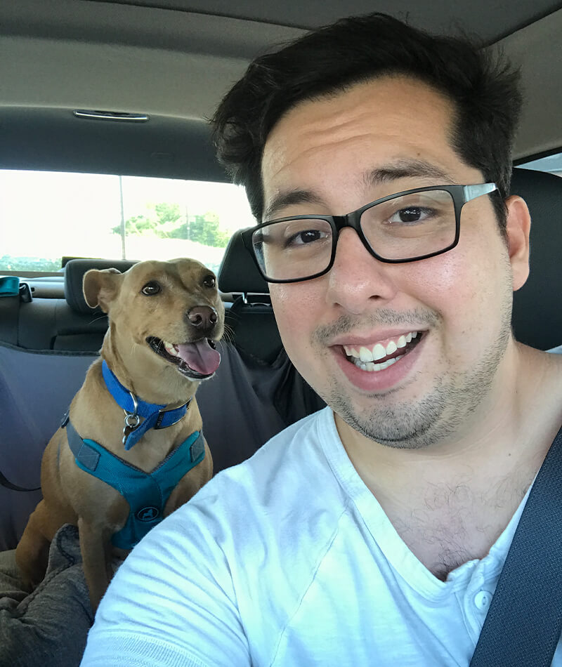 Chris and his dog, Missy, taking a selfie in his car.
