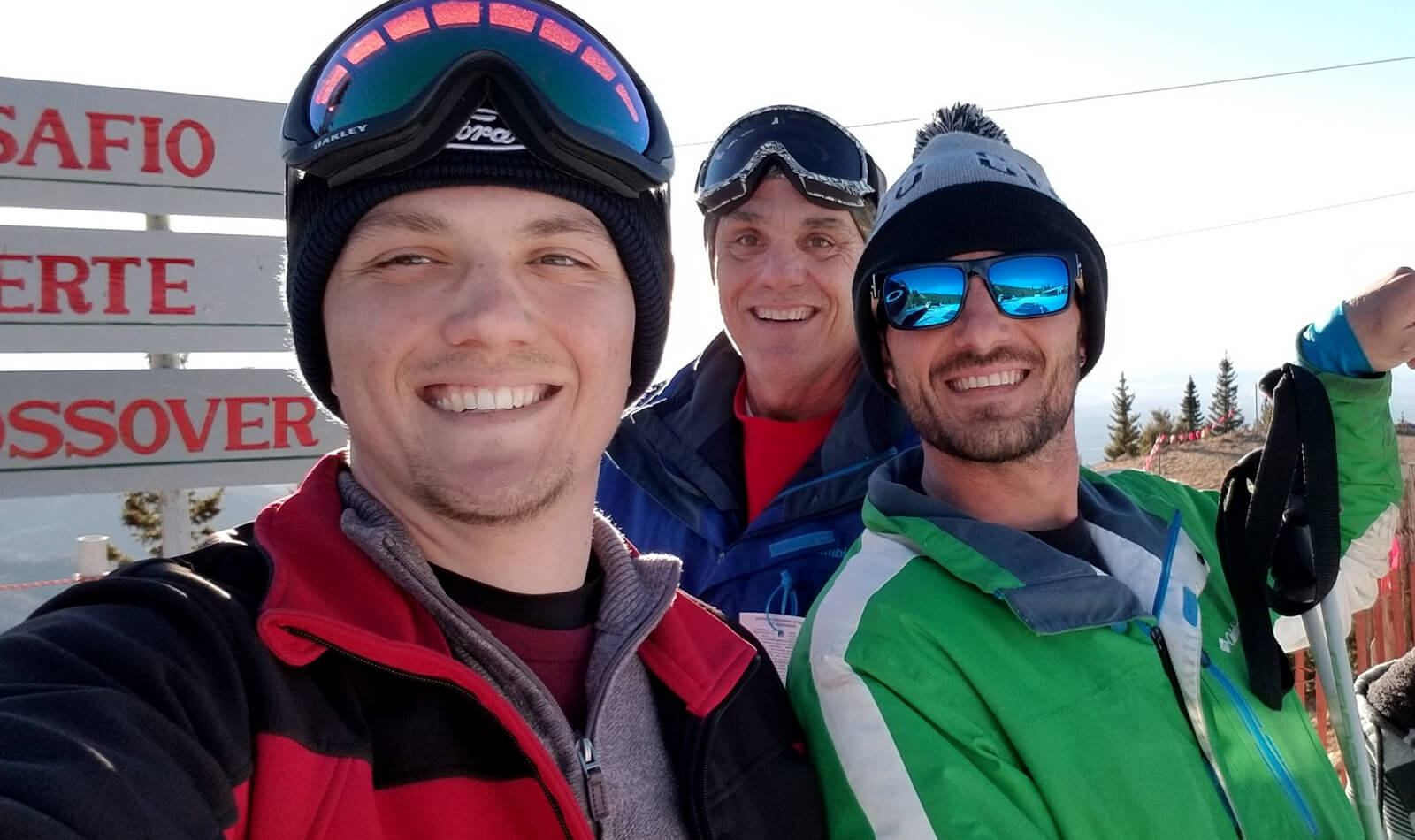 Luke and family taking a selfie out on the slopes after skiing.