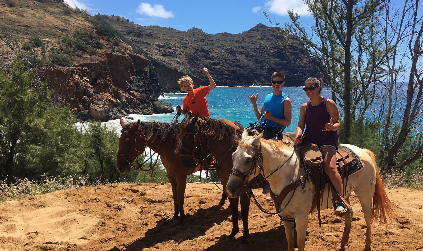 Nicole and her family riding horses on their most recent trip to Hawaii.